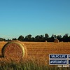 Created by: Tony Lau<br/> Description: The late afternoon sun hitting a field of hay by Tony Lau Photography<br/>
