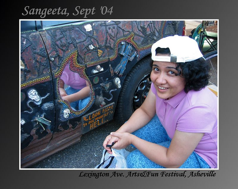 Sangeeta by a mirror of 'Heaven and Hell' car at Lexington Ave Festival, Asheville [gradient and textured border, text]