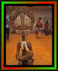Statue with dancers in bg [black-red-green Kwanzaa colored borders]