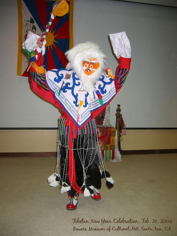 A masked colorful Tibetan dancer 2 [text]