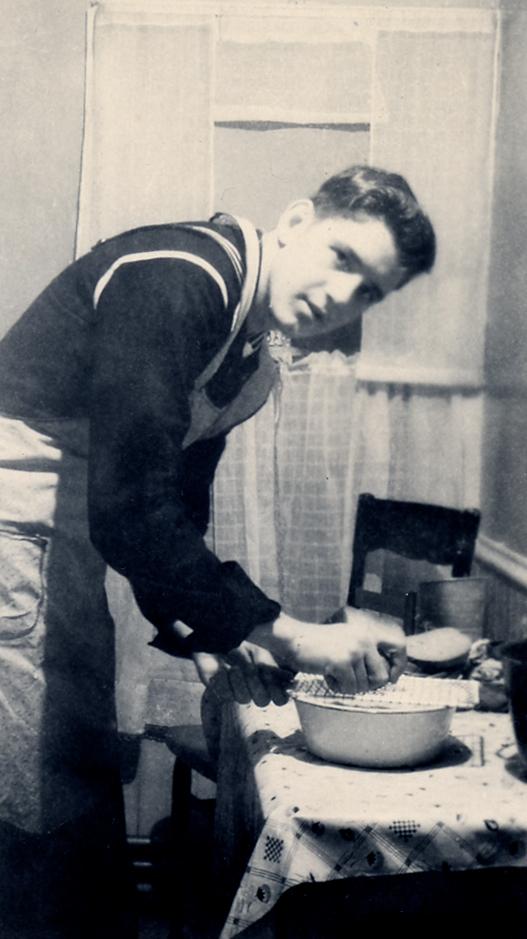 Circa:1945, Art home from the Navy, making potato pancakes