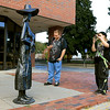 The metal statues are back on Main Street to promote the Artsmith Festiva that will be held October 8, 2016 at 10 a.m. to 5 p.m. at Fitchburg Riverfront Park on Boulder Drive. The rain date is October 9, 2016. Stopping to take a picture of one of them is Jessica Mailloux, 19, of Fitchburg with George Reczek, 29, also of Fitchburg. SENTINEL & ENTERPRISE/JOHN LOVE