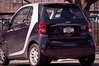 """I spotted this tiny Smart Car parked in a lot downtown. There's nothing much remarkable about it, except for the license plate - """"Huge"""". On a car that's probably 6 feet long. Nicely done :)"""