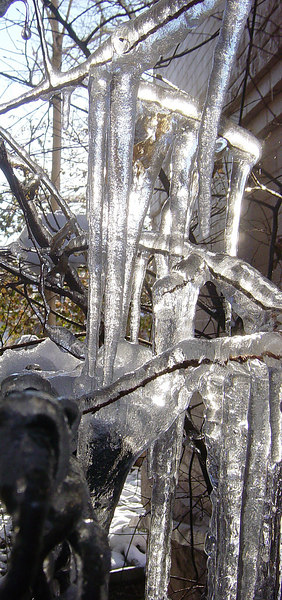 Morning sun shining through late season icicles.<br /> <br /> Taken: Friday, March 30th<br /> Edits: Cropped