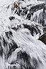 I passed this wild little waterfall on a long springtime hike near Rollins pass. There was still lots of snow on the ground and tons of snowmelt flowing in the river. <br /> <br /> Photographically, I reallyI like all the texture. I think it conveys how energetic this part of the waterfall was.