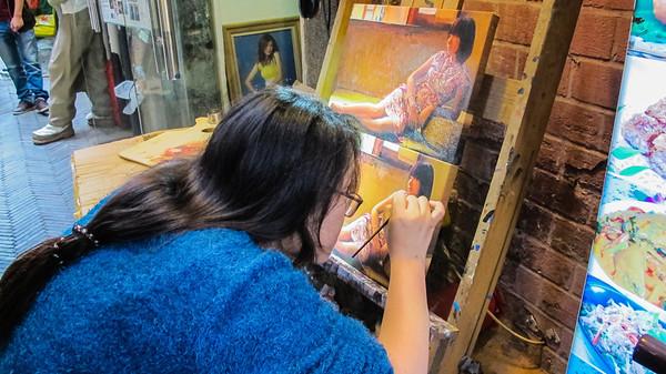 An oil painting ninja at Tan Zi Fang in Shanghai, China.