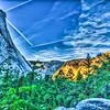 Yosemite Valley with airplane water vapor trails.