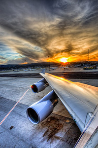United Airlines 747 wing sunset