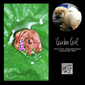 "GARDEN GIRL- Teeny Brooch Pin  This little fur kid is so tiny and sweet...the perfect lapel brooch for your jacket or even a hat pin!  GARDEN GIRL lies patiently in her master's garden waiting for the new shipment of potted garden annuals to arrive.  Her favorite  pastime is to help mom plant  (and unplant) the annuals as they are placed in the garden.  The colors as so pretty in this one.  Little poppies and delphiniums handsculpted on the tip of a needle highlight this wee brooch. BROOCH MEASURES 1"" X 1 1/4""   THIS ITEM WILL BE AVAILABLE AT 7:00 PM EST AT THIS LINK"