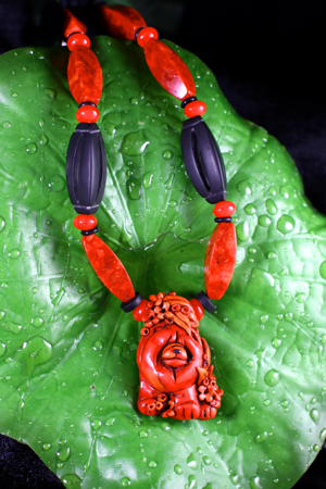 CORAL STATEMENT Faux coral pendant with sponge coral beads $145.00