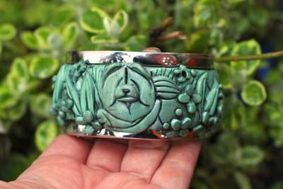 JADE IMPRESSIONIST  (front side) Faux Jade handsculpted hinged cuff bracelet  $195.00