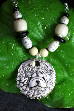 IVORY ARTISTRY Faux ivory hand sculpted necklace $155.00