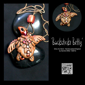 "BACKSTROKE BETTY TURTLE NECKLACE  Betty the Seaturtle is entered in the Pacific Crawl turtle race this summer and needs a personal trainer to help her build up her stamina and technique......thats where YOU come in!  This beautiful girl has the makings of a winner, from her iridescent coral/magenta head and tail to her Swarovski crystal studded shell.  Her huge eyes are so soft and expressive!!!  She literally 'floats' from the micro fine ball chain which you can cut to your own size if you wish, or can be work on your own chain as well.  A pearlized lucite ""slider"" bead is included.  PENDANT MEASURES  2  x 2""   On a 24"" bronze tone micro ball chain (may be cut to size)"