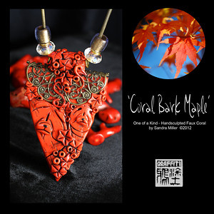 "I have a ""thing"" for coral as the colors are so varied and rich, they just make you feel warm wearing them.    Since I have never seen a REAL coral chow carving, it became necessary for me to figure out how to create one!!      This vibrant chow family is FULL of blended shades of HOT...from coral orange to deep reds.  The bail which the necklace is strung through is actually part of the sculpture and covered in teeny flowers and maple leaves. The same miniature maple leaves surround the Mama and her baby chow throughout the design    The top of this large wedge pendant is encased on both sides with an antiques brass filigree crescent and the chain matches the filigree perfectly.  2 sparkly large crystals and vintage lucite beads add a subtle bit of eyecatching glitz.      The FAUX CORAL I create from polymer clay which was painstakingly layered, thinly sliced and layered again and again to bring out the rich orange/red tones and translucent quality of real branch coral!!! You can see the real coral in the background of many of the photos for comparison.  I even introduce ""fissures"" and pock marks for that realistic touch!      After firing , the entire pendant was covered in black paint (always a ""cringe"" moment ) and baked on , followed by hours of sanding and buffing off the paint to reveal the exquisite details of the sculpting beneath. It looks for all the world like finely finished coral without the weight or high price tag of the real deal!!         This one of a kind design is an heirloom of the future and sure to attract many ooohs and ahhhhs wherever you wear this sweet sweet chow family.      PENDANT MEASURES   3 1/2""tall x 2"" wide    The necklace can be adjusted from 16-21"" long with an antiqued brass tone chain and lobster clasp    The chain has a removable end to add or subtract beads and charms."