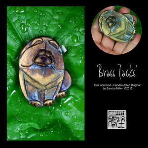 "BRASS TACKS PIN-for men or women!  I only created 2 brooches in my METAL VENEER technique and this is one of them.  They are so time consuming but sooooo worth the effort put into them. The real metal surface is very evident in this design.  After sculpting this original sitting chow design,  I add layer upon layer of real  brass until I get a thick coating which will accept the patina later on.  After firing, I hand apply the acids and chemicals to accelerate the aging process of the metal , then seal the design to keep it just as it is forever!   On this particular chow I got some incredible blue and green tones on the brass which  looks as though it might have been unearthed from an archeological dig in China!  Each time I do this I never know what I will get and many times need to add or subtract the patina by buffing to adjust the aged look.  It's quite the process and a real challenge which I love.  This is a larger pin which would look great on both a man's suit or a women's  jacket, sweater or coat.  Don't let the ""metals fool you as far as weight.  That's the beauty of this process is the polymer clay is lightweight under the veneer making these far lighter and less expensive than a solid brass design.   BROOCH MEASURES 2 1/2"" X 1 3/4"