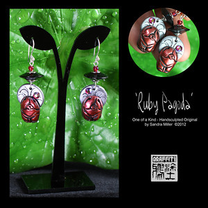 """RUBY PAGODA EARRINGS  You will LOVE these earrings created using my Faux Metal technique.  They are as light as a feather and look like teeny Chow pagodas.  The black """"pagoda roof"""" disc is 1950's vintage lucite and the little chows I handsculpted in their own little scene featuring a moon backdrop and Swarovski crystal on each for a flash of light when you move your head.  There is a lot of detail in such a small space here .  This set is also available in another listing in a Silver/Brass color.  EARRINGS MEASURE 1 1/2"""" long x 3/4"""" wide  without the French wire"""