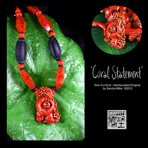 "CORAL STATEMENT Faux and real sponge coral necklace  I have a ""thing"" for coral as the colors are so varied and rich, they just make you feel warm wearing them.    Since I have never seen a REAL coral chow carving, it became necessary for me to figure out how to create one!!  This little lady is FULL of blended shades of HOT...from coral orange to deep reds.  The bail which the necklace is strung through is actually part of the sculpture and covered in teeny flowers and leaves. The same miniature coral garden surrounds her chubby paws at the bottom of the pendant  The FAUX CORAL I create from polymer clay which was painstakingly layered, thinly sliced and layered again and again to bring out the rich orange/red tones and translucent quality of real branch coral!!! You can see the real coral in the background of many of the photos for comparison.  I even introduce ""fissures"" and pock marks for that realistic touch!  After firing , the entire pendant was covered in black paint (always a ""cringe"" moment ) and baked on , followed by hours of sanding and buffing off the paint to reveal the exquisite details of the sculpting beneath. It looks for all the world like finely finished coral without the weight or high price tag of the real deal!!  The necklace is the last of my real sponge coral beads which I purchased in Thailand in 2006 at the Jatuchek Market in Bangkok. What a match to the pendant.  I also added 2 large hand carved matte finished black onyx beads and discs for contrast. Those large beads are carved all the way through!  This one of a kind design is an heirloom of the future and sure to attract many ooohs and ahhhhs wherever you wear her.  PENDANT MEASURES   2""tall x 1 1/2"" wide  The necklace can be adjusted from 16-21"" long with a sterling chain and lobster clasp A Cinnabar carved round at the back of the chain is a perfect neck tickler!!"