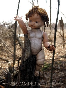 Baby doll in woods - a little creepy!