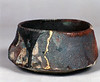 Bowl 9452, 1994.  3 x 5 x 5 in.  Low-fire, smoked, with glaze and slips.  Wheel thrown and altered.
