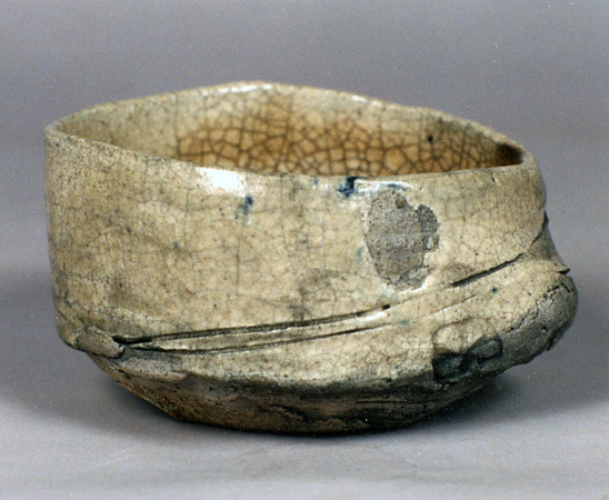Bowl 9449, 1994.  3.25 x 5.25 x 5 in.  Low-fire, smoked, with glaze and slips.  Wheel thrown and altered.