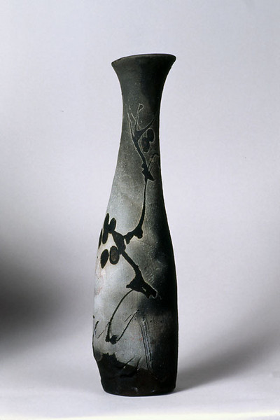 Vase 9219, 1992.  20 x 4.5 x 4 in.  Low-fire, smoked, unglazed, with slips and stains or oxides, wheel thrown and altered.