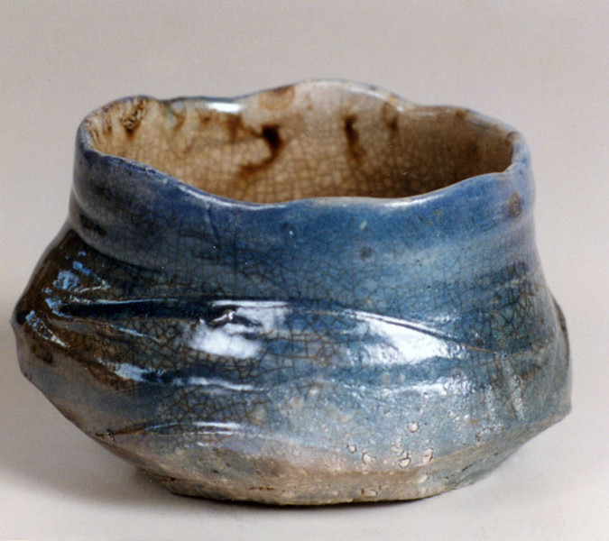 Bowl 9745, 1997.  3.75 x 6 x 5 in.  Low-fire salt, smoked, with glaze.  Wheel thrown and altered.