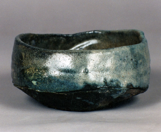 Bowl 9446, 1994.  2.75 x 5.5 x 5.25 in.  Low-fire, smoked, with glaze and slip.  Wheel thrown and altered.