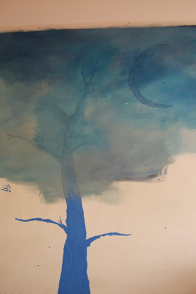 first sky layer, painted over the tree, moon, and star tape stencils