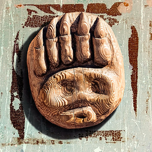 Photo manipulation of a wooden door handle in the shape of a face and claw. Door handle shot in Stockholm and blended with two texture images from my stock.