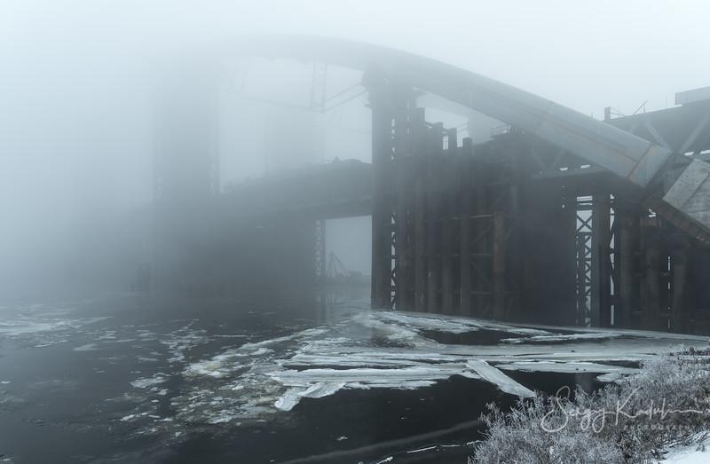 Podilsky bridge in the fog.
