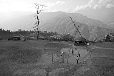 Swinging in the sun. Early morning in Darjeeling, India.