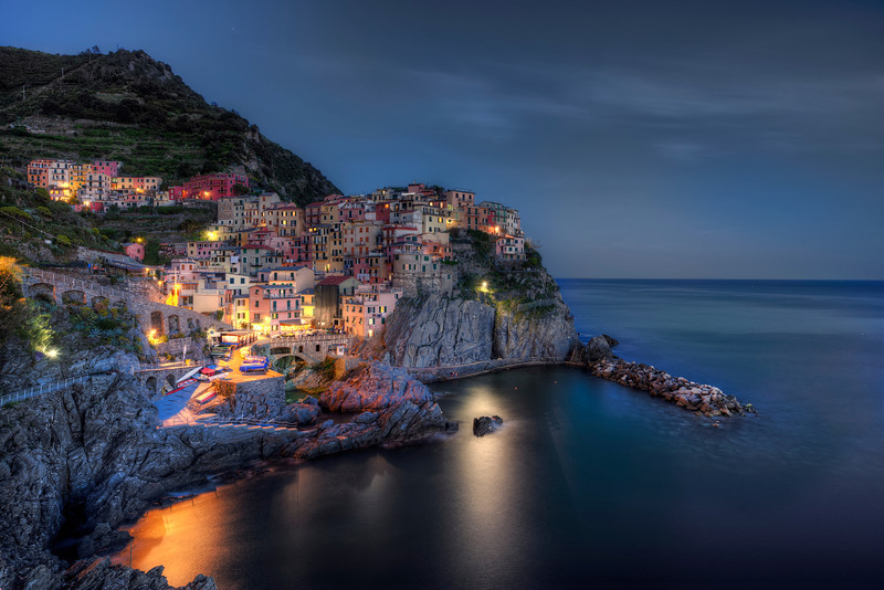 """Blue Hour - Instead of an abandoned place, this time a Blue hour shot of Manarola, one of 5 """"Cinque Terre"""" villages in Italy. These 5 villages have been placed on the UNESCO world heritage list."""