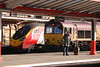 390 052 / 66 043 <br /> <br /> Man ignores 66 043 and a pendo at Crewe <br /> <br /> Dec 2nd 2012