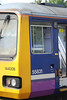 The station Sign at Knottingley is reflected in the cab window of 144 008