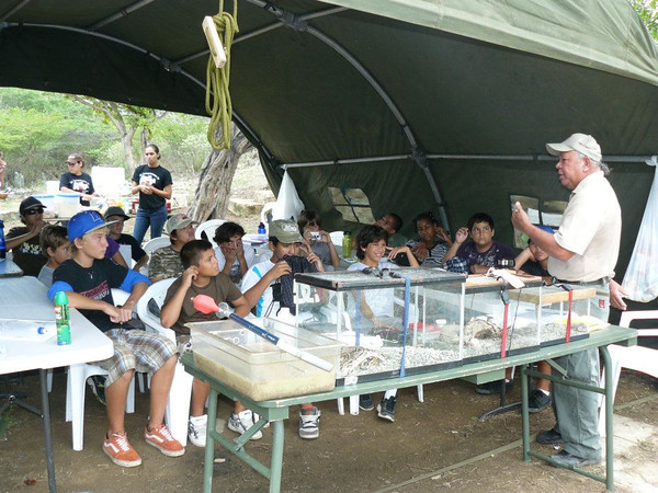 Park Ranger Mr. Agapito teaching the Junior Rangers about the snakes of Aruba