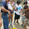 Head park ranger Mr. Salvador catching a wild boa constrictor