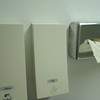 Lotion and soap dispensers in bathroom.