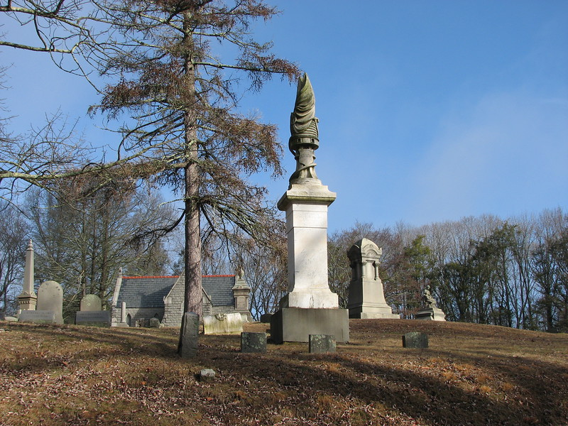 Gravestone of Capt. Elisha and Abigail Hinman in Cedar Grove Cemetery. To find the grave, enter through the main gate, drive past the office/gatehouse building and proceed straight ahead to the far end of the cemetery. Look for a beautiful stone chapel (which can be seen in this photo.) At the very back edge of the cemetery is a small pond. This photo is taken with the pond directly behind the photographer, and looking toward the stone chapel.