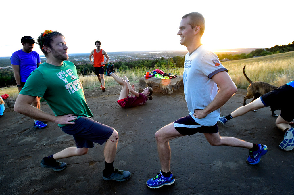 . Sean Pomeroy, left, and TJ Kirk do lunges together at the Ascenders Project workout at Chautauqua in Boulder on Wednesday September 12, 2018.  For more photos go to dailycamera.com (Photo by Paul Aiken/Staff Photographer)
