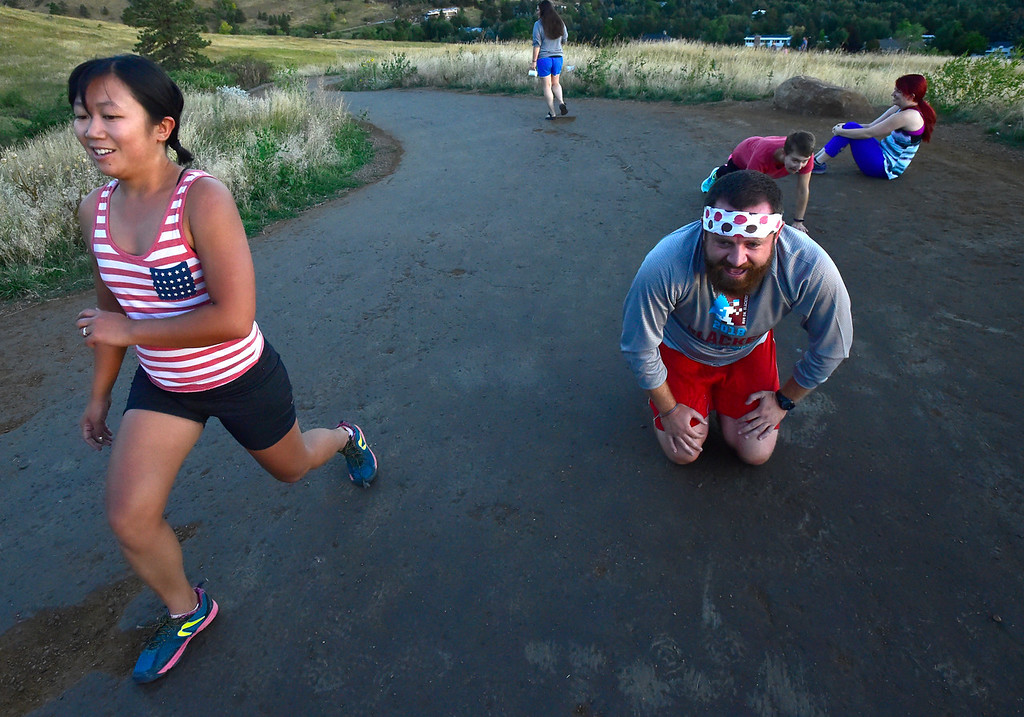 . Ian Stafford takes a break from pushes as Jamie Pomeroy does lunges at the Ascenders Project workout at Chautauqua in Boulder on Wednesday September 12, 2018.  For more photos go to dailycamera.com (Photo by Paul Aiken/Staff Photographer)