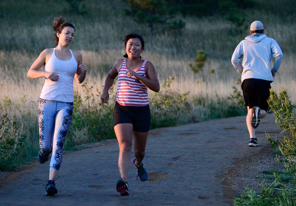 . Lily Sussman, left, and Jamie Pomeroy head down the hill after their run segment at the Ascenders Project workout at Chautauqua in Boulder on Wednesday September 12, 2018.  For more photos go to dailycamera.com (Photo by Paul Aiken/Staff Photographer)