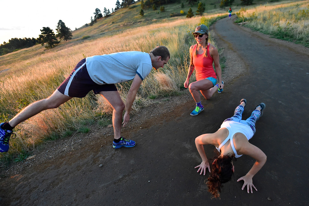 . TJ Kirk, left, Rachel Bigby and Lily Sussman work various exercises at the Ascenders Project workout at Chautauqua in Boulder on Wednesday September 12, 2018.  For more photos go to dailycamera.com (Photo by Paul Aiken/Staff Photographer)