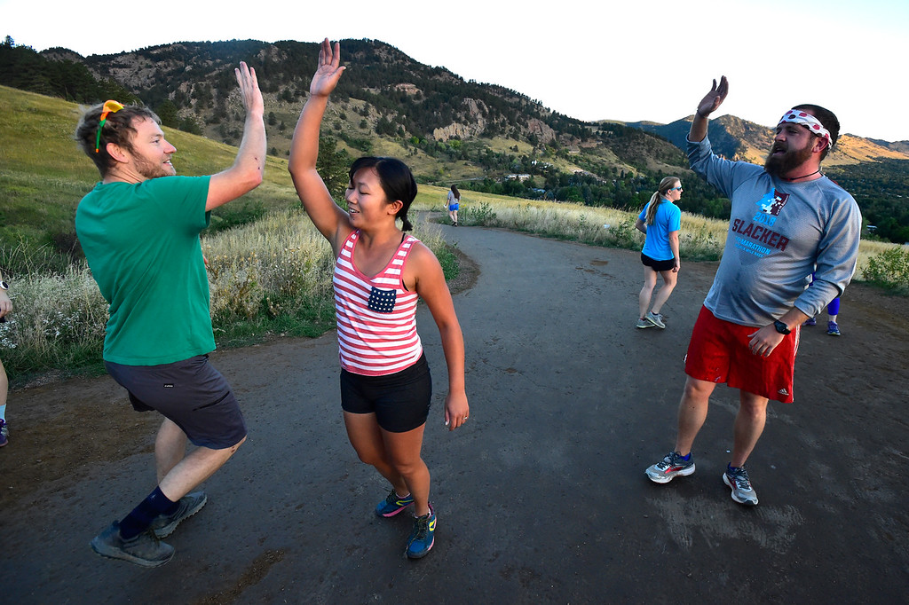 . Sean and Jamie Pomeroy high five as as Ian Stafford waits at right at the Ascenders Project workout at Chautauqua in Boulder on Wednesday September 12, 2018.  For more photos go to dailycamera.com (Photo by Paul Aiken/Staff Photographer)