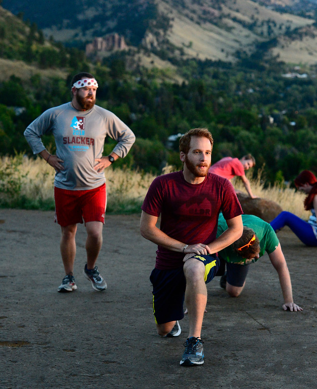 . Josh Buchsbaum performs lunges during the Ascenders Project workout at Chautauqua in Boulder on Wednesday September 12, 2018.  For more photos go to dailycamera.com (Photo by Paul Aiken/Staff Photographer)