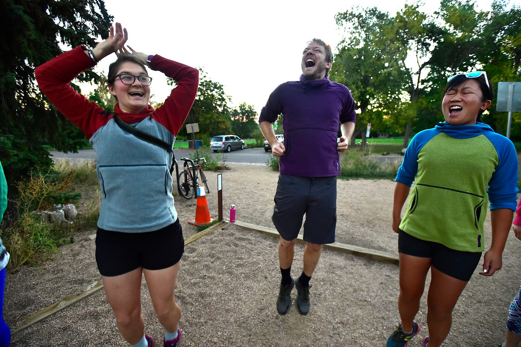 . From left to right, Polly Murray, and Sean and Jamie Pomeroy lead the group in an early morning wakeup cheer at the Ascenders Project workout at Chautauqua in Boulder on Wednesday September 12, 2018.  For more photos go to dailycamera.com (Photo by Paul Aiken/Staff Photographer)