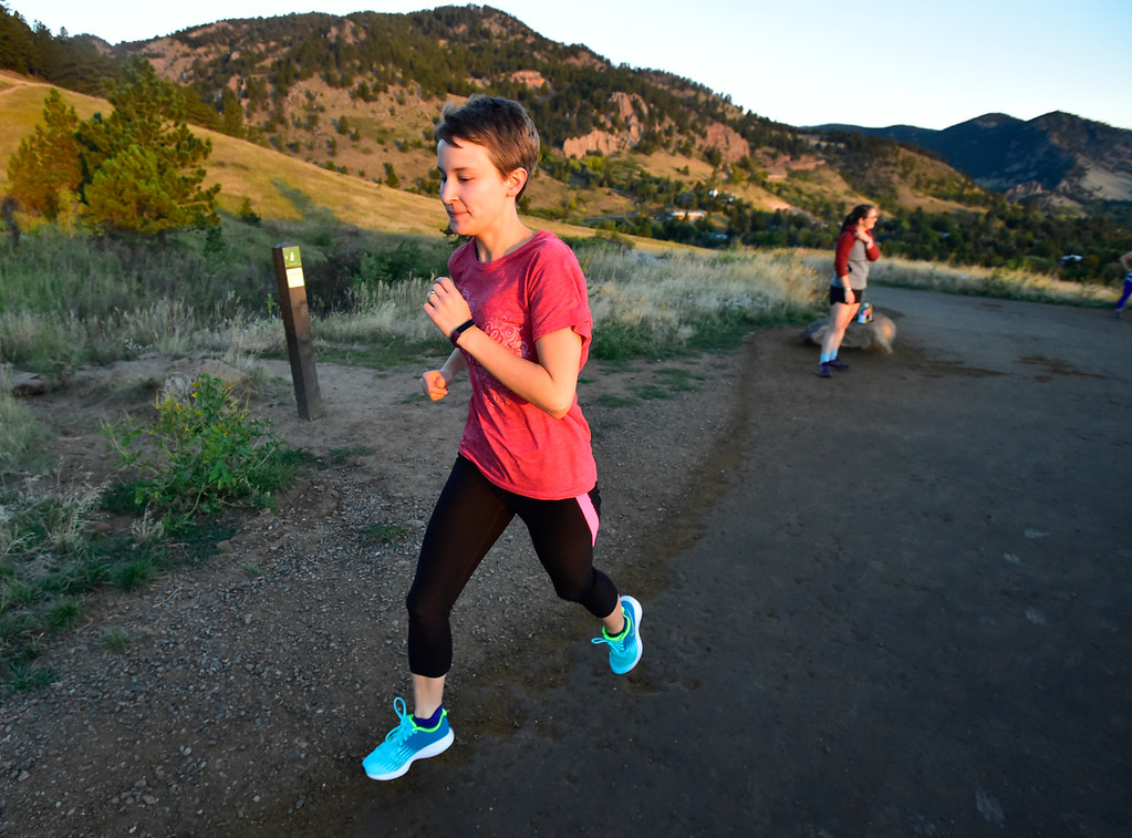 . Mikhaila Redovian heads up the hill at the Ascenders Project workout at Chautauqua in Boulder on Wednesday September 12, 2018.  For more photos go to dailycamera.com (Photo by Paul Aiken/Staff Photographer)