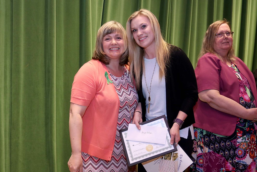 . Ashburnham-Westminster Special Education Parent Advisory council held their first remarkable inspiration in special education awards on Thursday, May 3, 2018. Adjustment Counselor at Overlook Middle School Taryn Holman, on right, stands with SEPAC Co-Chair Kendra Steucek as she receives one of the award at the event. SENTINEL & ENTERPRISE/JOHN LOVE