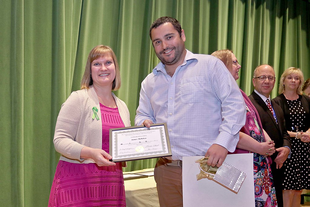 . Ashburnham-Westminster Special Education Parent Advisory council held their first remarkable inspiration in special education awards on Thursday, May 3, 2018. Special Education Teacher Oakmont High School James Mellekas, on right, stands with SEPAC Co-Chair Kim Caisse as he receives one of the award at the event. SENTINEL & ENTERPRISE/JOHN LOVE