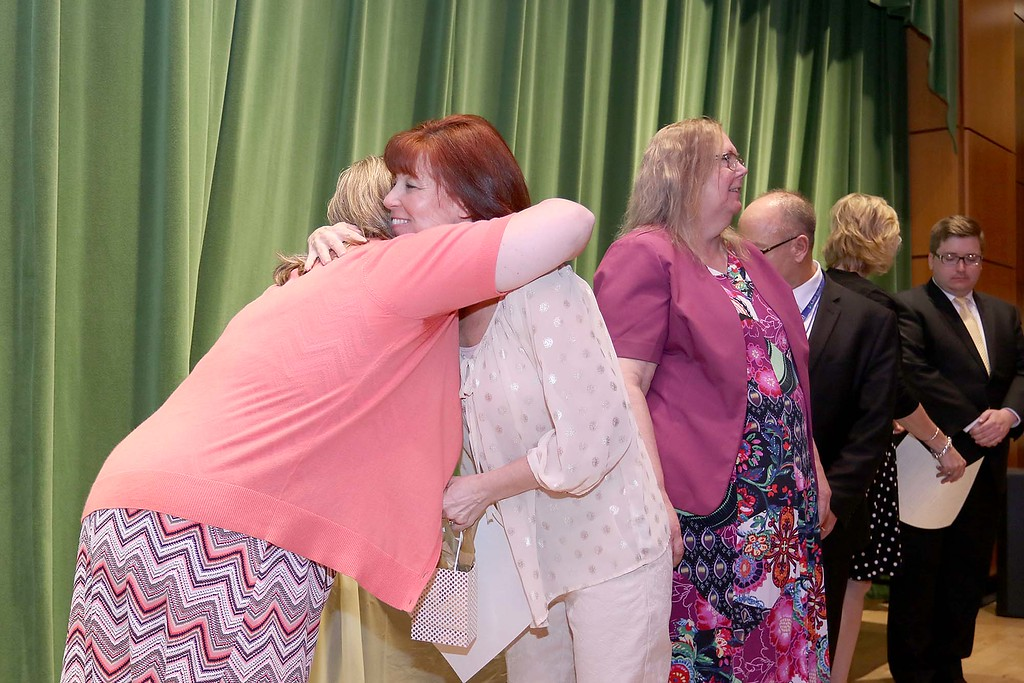 . Ashburnham-Westminster Special Education Parent Advisory council held their first remarkable inspiration in special education awards on Thursday, May 3, 2018. Special Education teacher at J.R. Briggs Elementary School Renee Caldwell is given a hug by SEPAC Co-Chair Kendra Steucek  as she receives one of the award at the event. SENTINEL & ENTERPRISE/JOHN LOVE