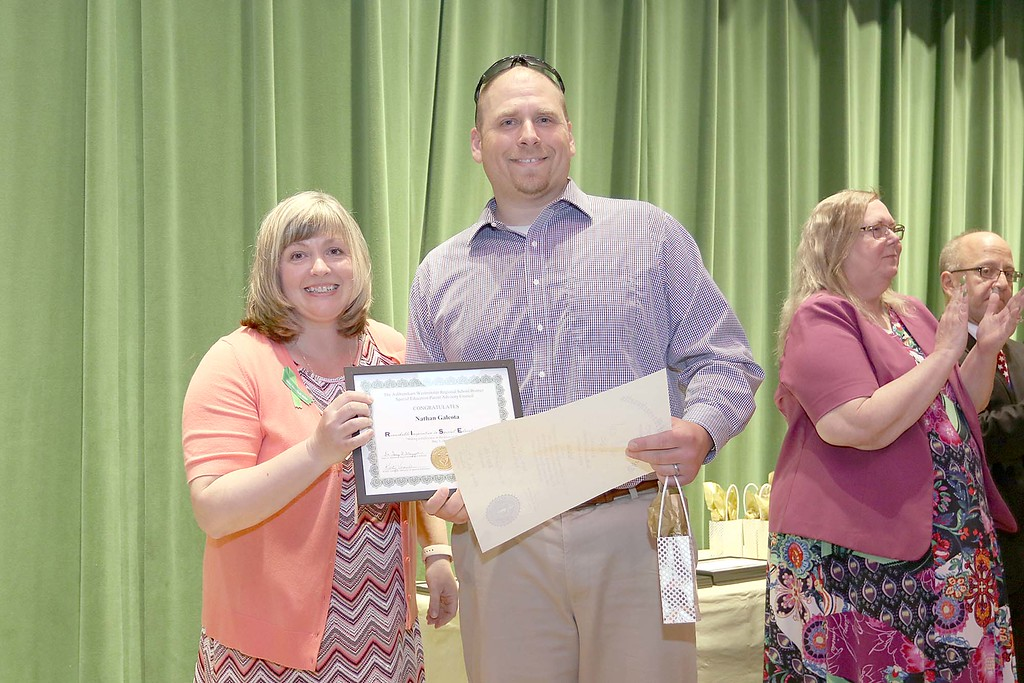 . Ashburnham-Westminster Special Education Parent Advisory council held their first remarkable inspiration in special education awards on Thursday, May 3, 2018. Vision Specialist at J.R. Briggs Elementary SchoolNathan galeota, on right, stands with SEPAC Co-Chair Kendra Steucek as he receives one of the award at the event. SENTINEL & ENTERPRISE/JOHN LOVE